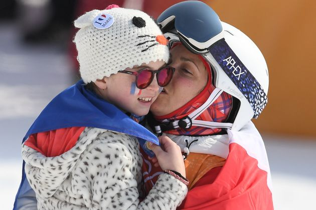 France's Marie Martinod celebrates with her daughter after the women's ski halfpipe