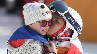 France's Marie Martinod celebrates with her daughter after the women's ski halfpipe final during the Pyeongchang 2018 Winter Olympic Games at the Phoenix Park in Pyeongchang on February 19, 2018. / AFP PHOTO / LOIC VENANCE        (Photo credit should read LOIC VENANCE/AFP/Getty Images)