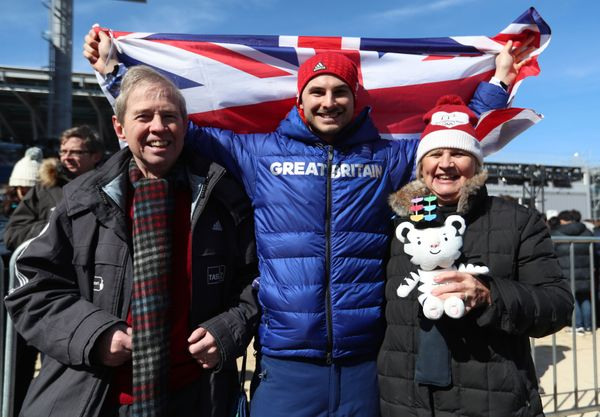 Dom Parsons poses with his parents after getting a bronze medal in the men's skeleton.