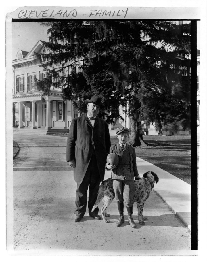 Cleveland with his son, Francis, and dog.