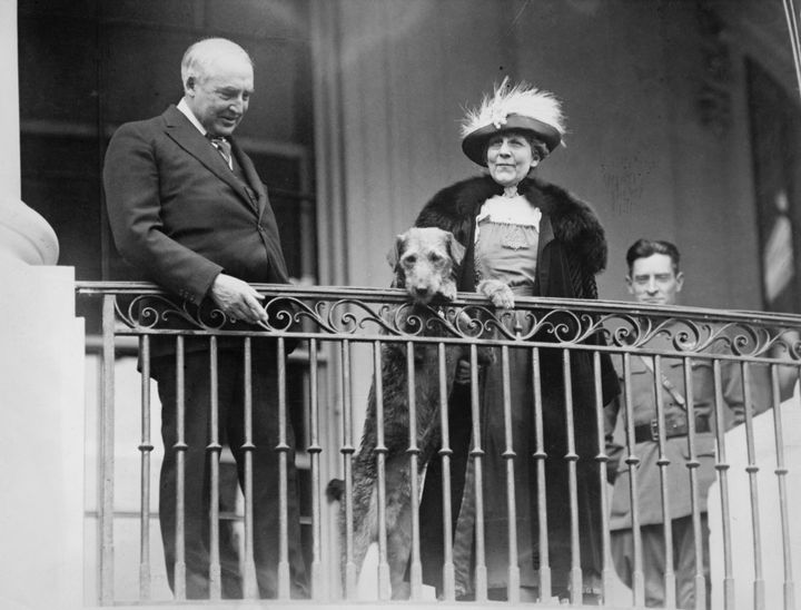 Harding and his wife, Florence, watching an annual White House Easter event with Laddie Boy, circa 1922.