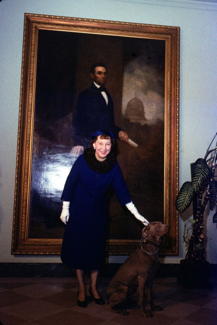 First Lady Mamie Eisenhower poses with pet Weimaraner Heidi, who had just been awarded a lifetime membership to the Tailwagge