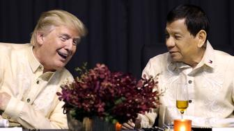 U.S. President Donald Trump speaks with Philippines President Rodrigo Duterte during the gala dinner marking ASEAN's 50th anniversary in Manila, Philippines, November 12, 2017. REUTERS/Athit Perawongmetha