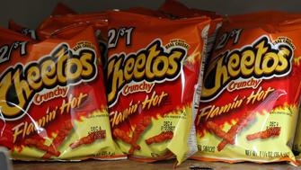 Bags of Cheetos Flamin' Hot Crunchy are displayed for sale at Touchdown Food Mart, September 27, 2012, in Chicago, Illinois. (John J. Kim/Chicago Tribune/MCT via Getty Images)