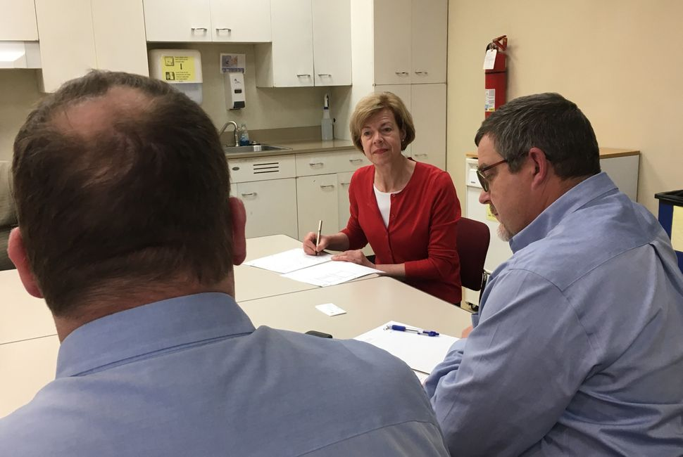 Sen. Tammy Baldwin (D-Wis.) met with dairy farmers in Altoona, Wis.