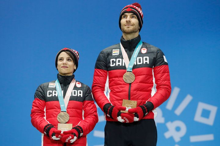 Canada's Eric Radford, right, became the first openly gay man to win a gold medal at a Winter Olympics this month.