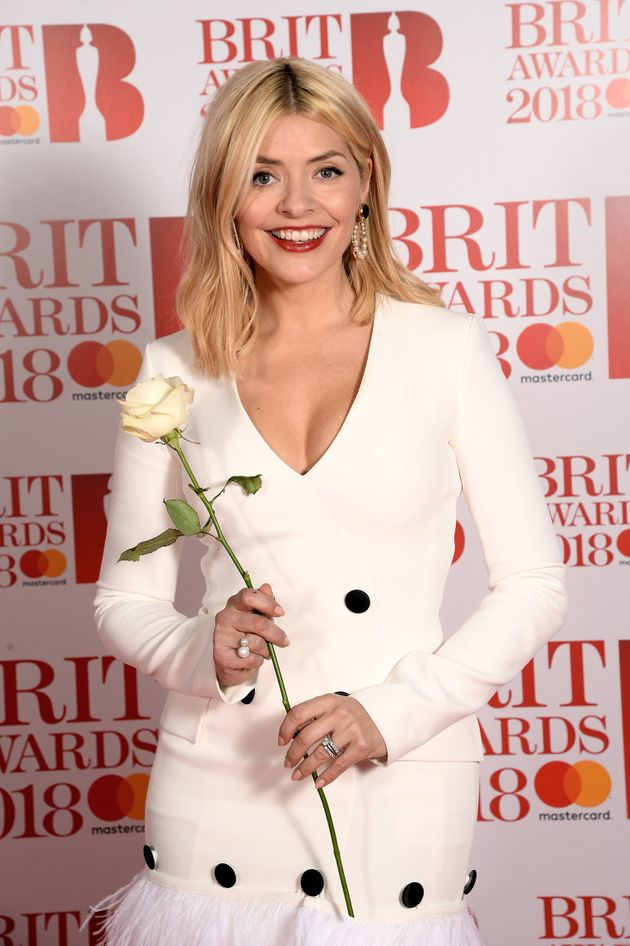 Holly Willoughby was one of the many stars carrying white roses at the Brit