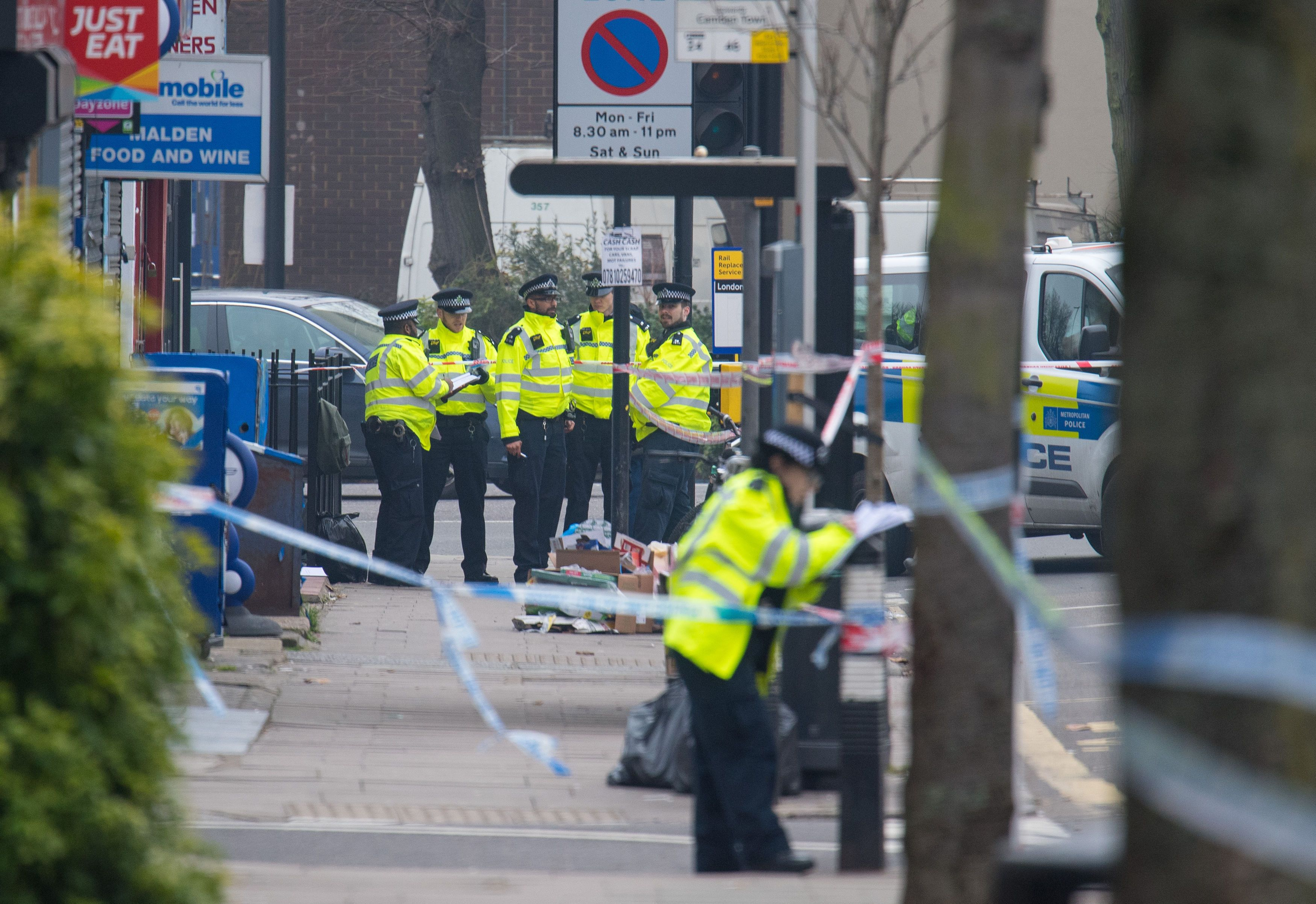 Police are the scene of one of the three stabbings, on Malden Road,