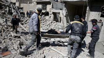 ATTENTION EDITORS - VISUAL COVERAGE OF SCENES OF DEATH OR INJURY People carry a body on a stretcher as they walk on rubble of damaged buildings in the rebel-held besieged town of Hamouriyeh, eastern Ghouta, near Damascus, Syria, February 21, 2018. REUTERS/Bassam Khabieh   TEMPLATE OUT