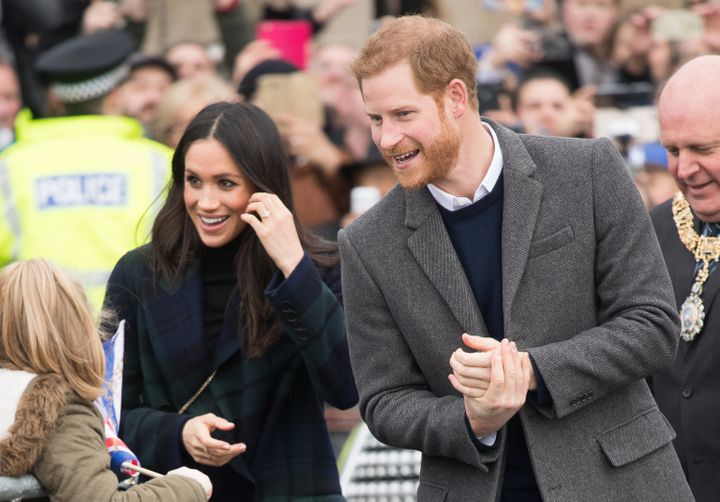 Meghan Markle and Prince Harrygreet fans on their way to Edinburgh Castle on Feb. 13. Markle gave one Filipino woman a particularlymemorable greeting during the visit.