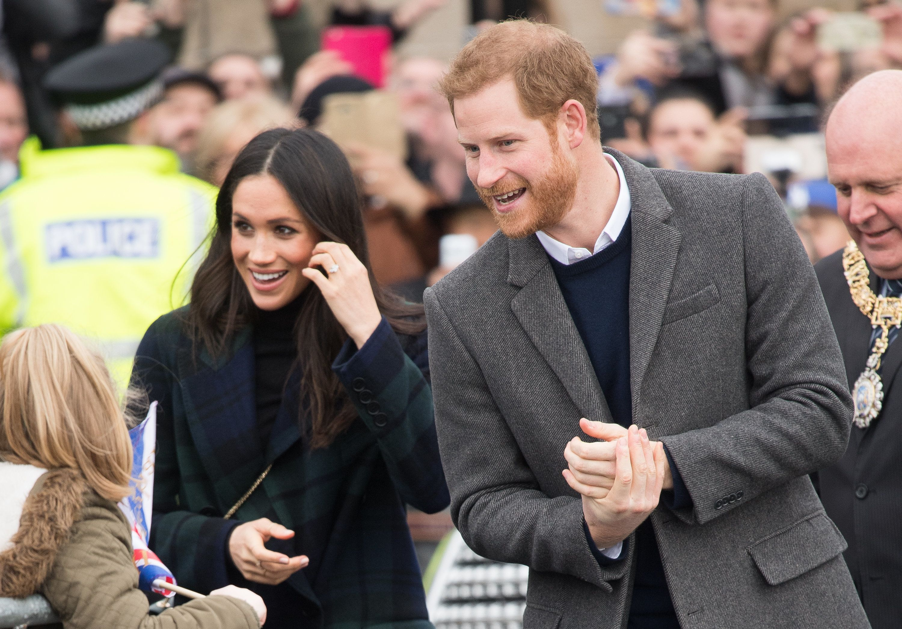 Meghan Markle and Prince Harry greet fans on their way to Edinburgh Castle on Feb. 13. Markle gave one Filipino woman a