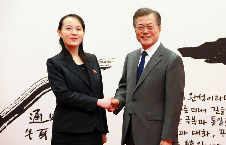 South Korea's President Moon Jae-in (R) posing with North Korean leader Kim Jong Un's sister Kim Yo Jong (L) before their mee