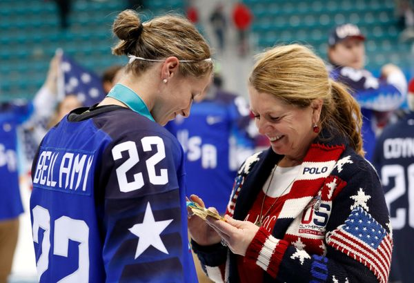 Kacey Bellamy shows her mother, Maura, her women's ice hockey gold medal onFeb. 22.