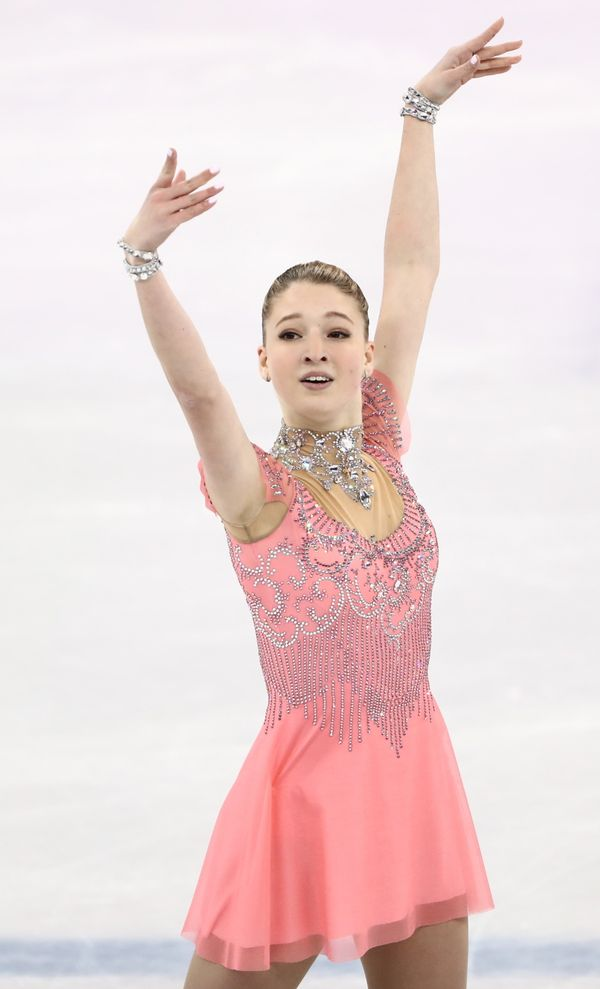 The skater from Russia was pretty in pink for her ladies short program. It's the embellished neckline and cuffs that really m