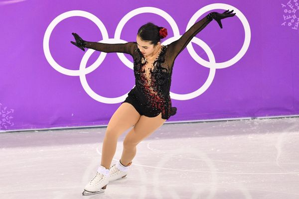 Chen, of the U.S., brought the drama in this lovely black costumewith red accent sparkles, which she wore for her free