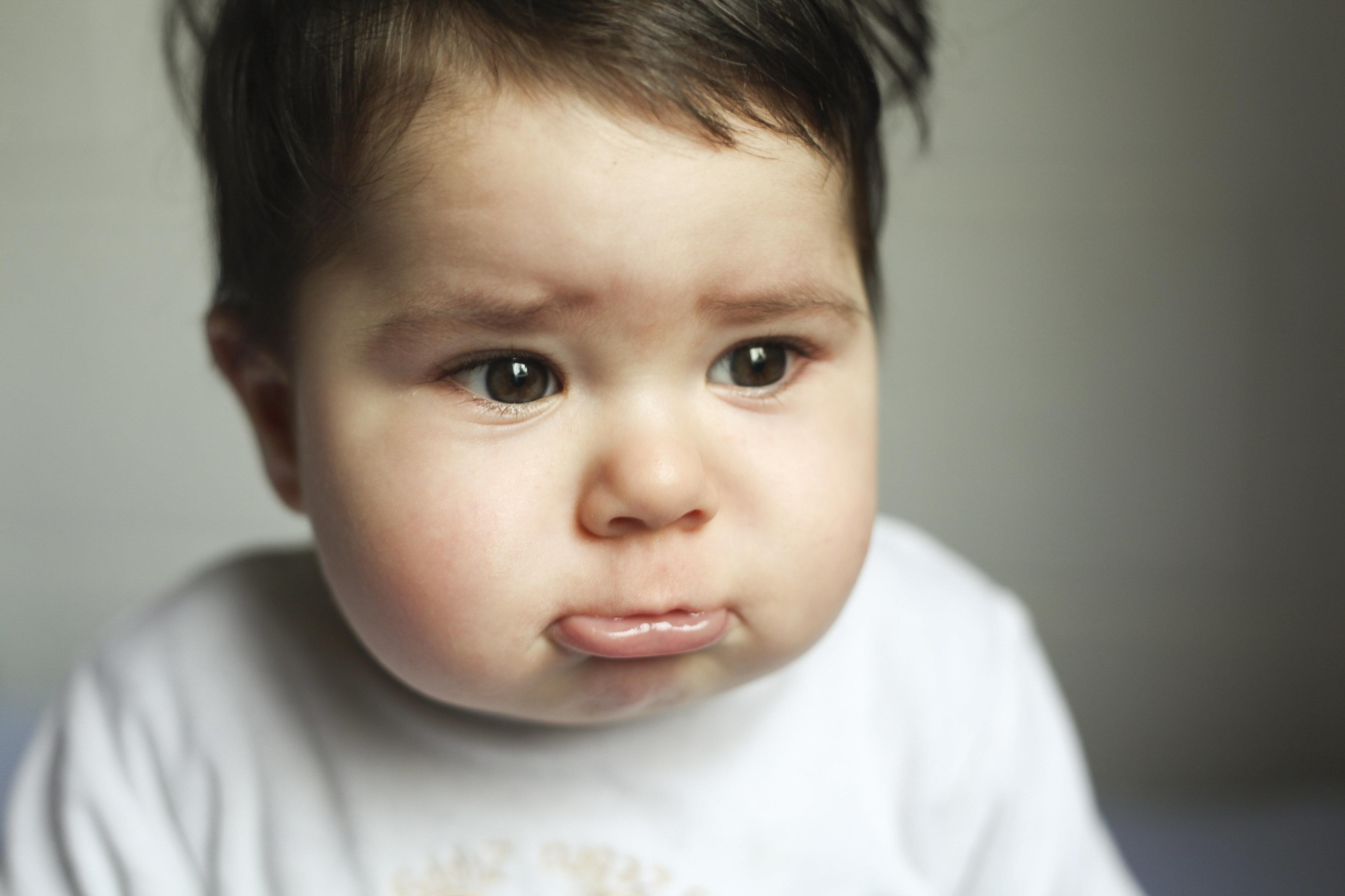 A 11-month baby boy sad ready to cry, Santa Cruz de Tenerife, Tenerife, Canary Islands, Spain.