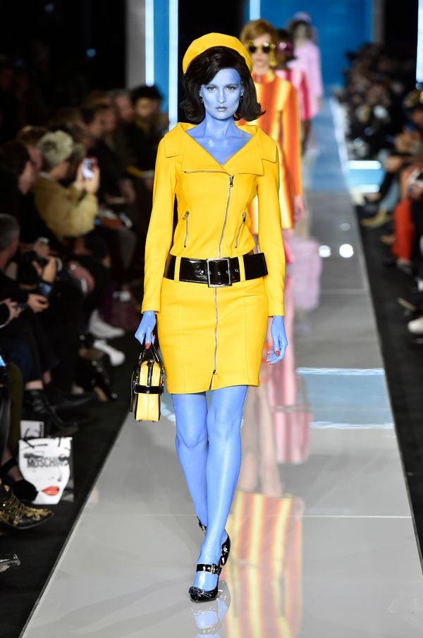 The clothes at Jeremy Scott's latest show for Moschino in Milan weren't all that wild, but the designer had some models paint