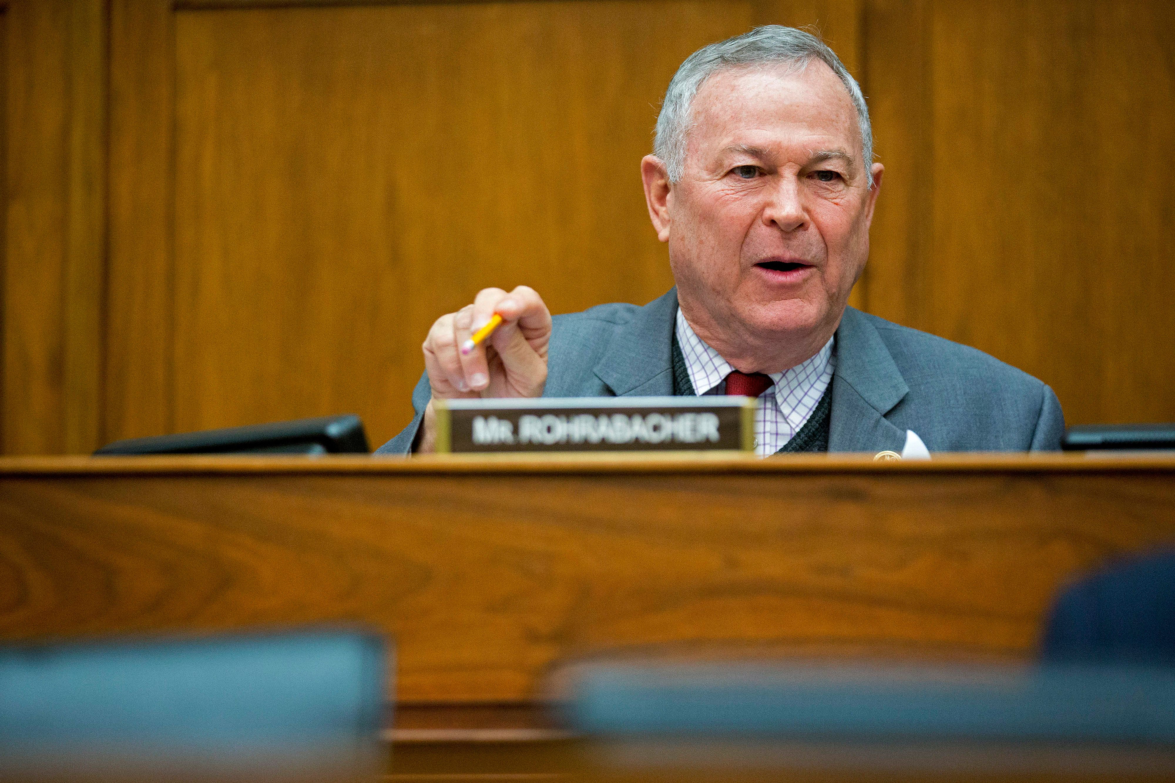 Representative Dana Rohrabacher, a Republican from California, questions Retired General John Allen, the special presidential envoy for the global coalition against Islamic State, not pictured, in Washington, D.C., U.S., on Thursday, March 26, 2015. The U.S. and allies began airstrikes on the Iraqi city of Tikrit, supporting Iranian-backed Shiite militias seeking to expel Islamic State fighters from the area. Asked whether Iran could end up controlling Iraq, Allen said, 'I don't think that's going to be the case. In the end, Iraq is an Arab country.' Iranians, he said, 'are a different people.' Photographer: Andrew Harrer/Bloomberg via Getty Images