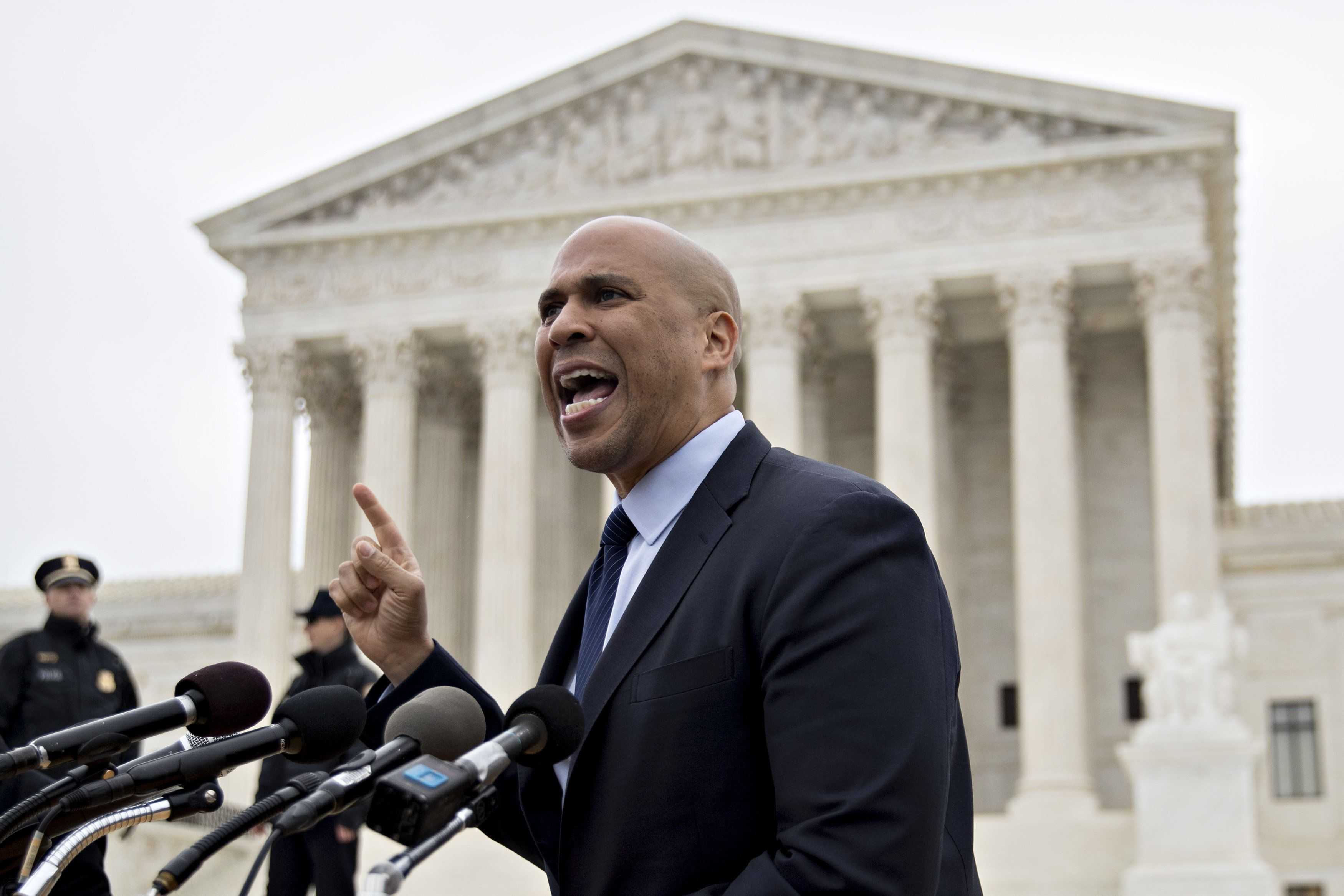 Senator Cory Booker, a Democrat from New Jersey, speaks to demonstrators in support of David Mullins and husband Charlie Craig outside the U.S. Supreme Court during arguments in the Masterpiece Cakeshop v. Colorado Civil Rights Commission case in Washington, D.C., U.S., on Tuesday, Dec. 5, 2017. Mullins and Craig filed a civil rights complaint to the Colorado Civil Rights Commission after Masterpiece Cakeshop owner Jack Phillips refused to make cakes for same-sex weddings. Photographer: Andrew Harrer/Bloomberg via Getty Images