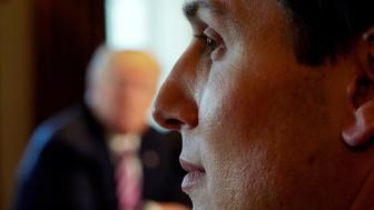 White House senior adviser Jared Kushner listens as U.S. President Donald Trump (background) holds a meeting on trade with members of Congress at the White House in Washington, U.S., February 13, 2018. REUTERS/Kevin Lamarque     TPX IMAGES OF THE DAY