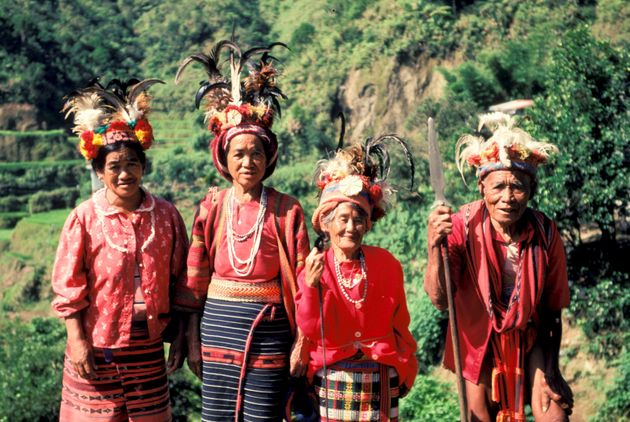 Ifugao women show their traditional costumes as they stand among rice terraces built by their ancestors...