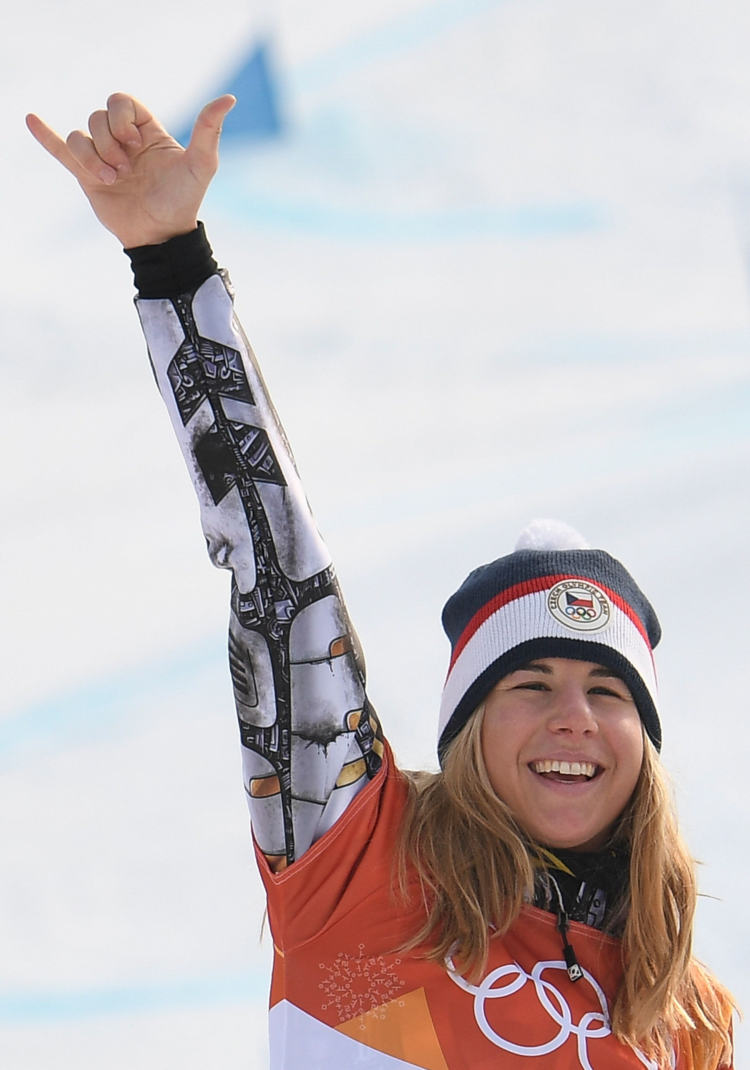 Gold medallist Czech Republic's Ester Ledecka celebrates on the podium during the victory ceremony for the women's snowboard parallel giant slalom event at the Phoenix Park during the Pyeongchang 2018 Winter Olympic Games on February 24, 2018 in Pyeongchang.  / AFP PHOTO / LOIC VENANCE        (Photo credit should read LOIC VENANCE/AFP/Getty Images)
