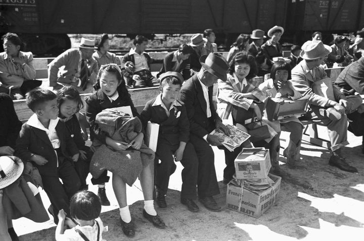 Japanese-Americans wait to be registered by the U.S. government in Los Angeles in April 1942.