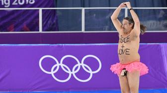 TOPSHOT - A shirtless man clad in a tutu dances on the rink following the men's 1,000m speed skating event medal ceremony during the Pyeongchang 2018 Winter Olympic Games at the Gangneung Oval in Gangneung on February 23, 2018. / AFP PHOTO / Mladen ANTONOV        (Photo credit should read MLADEN ANTONOV/AFP/Getty Images)