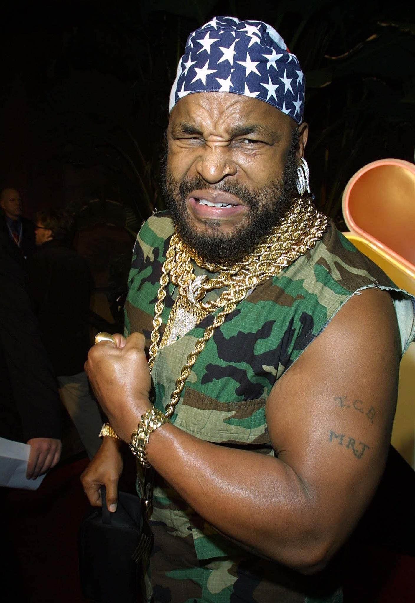 LOS ANGELES, UNITED STATES:  Mr. T, star of the former television series the A Team, shows his celebrated muscles at NBC's 75th anniversary all-star reception held at the Garden of Eden in Hollywood, 09 January 2002. Stars from previous and present NBC shows attended the reception.   AFP PHOTO STEWART COOK (Photo credit should read STEWART COOK/AFP/Getty Images)