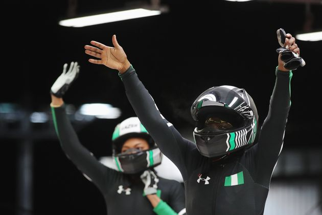 Seun Adigun and Akuoma Omeoga of Nigeria react in the finish area after competing during the Women's...