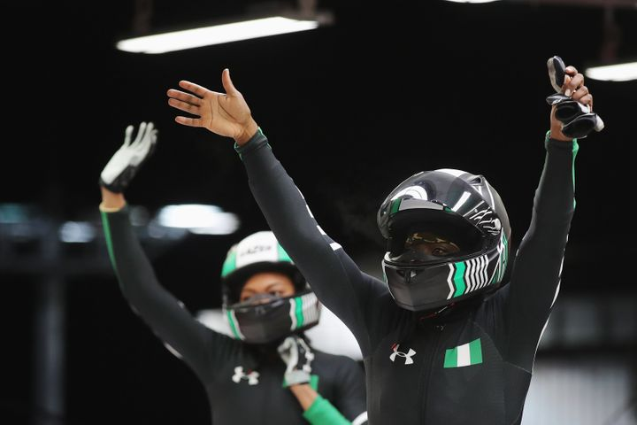 Seun Adigun and Akuoma Omeoga of Nigeria react in the finish area after competing during the Women's Bobsleigh heats on day t