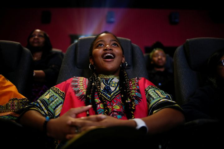 "Ron Clark Academy 6th grader De Ja Little, 12, joins classmates in watching the film ""Black Panther"" at Atlantic Station thea"