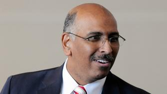 The Republican National Committee Chairman Michael Steele smiles as he takes a break from the floor as the RNC gathers to either re-elect or replace him at their winter meeting in National Harbor, Maryland, January 14, 2011. Steele struggled on Friday in his bid for a new term as Republican National Committee chairman with party leaders seemingly prepared to oust him and install a new chief for the 2012 elections.    REUTERS/Jonathan Ernst    (UNITED STATES - Tags: POLITICS)
