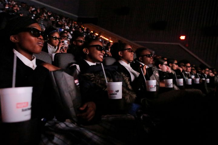 "A group of students from the Capital Preparatory Harlem School watch a screening of the film ""Black Panther"" on its opening n"
