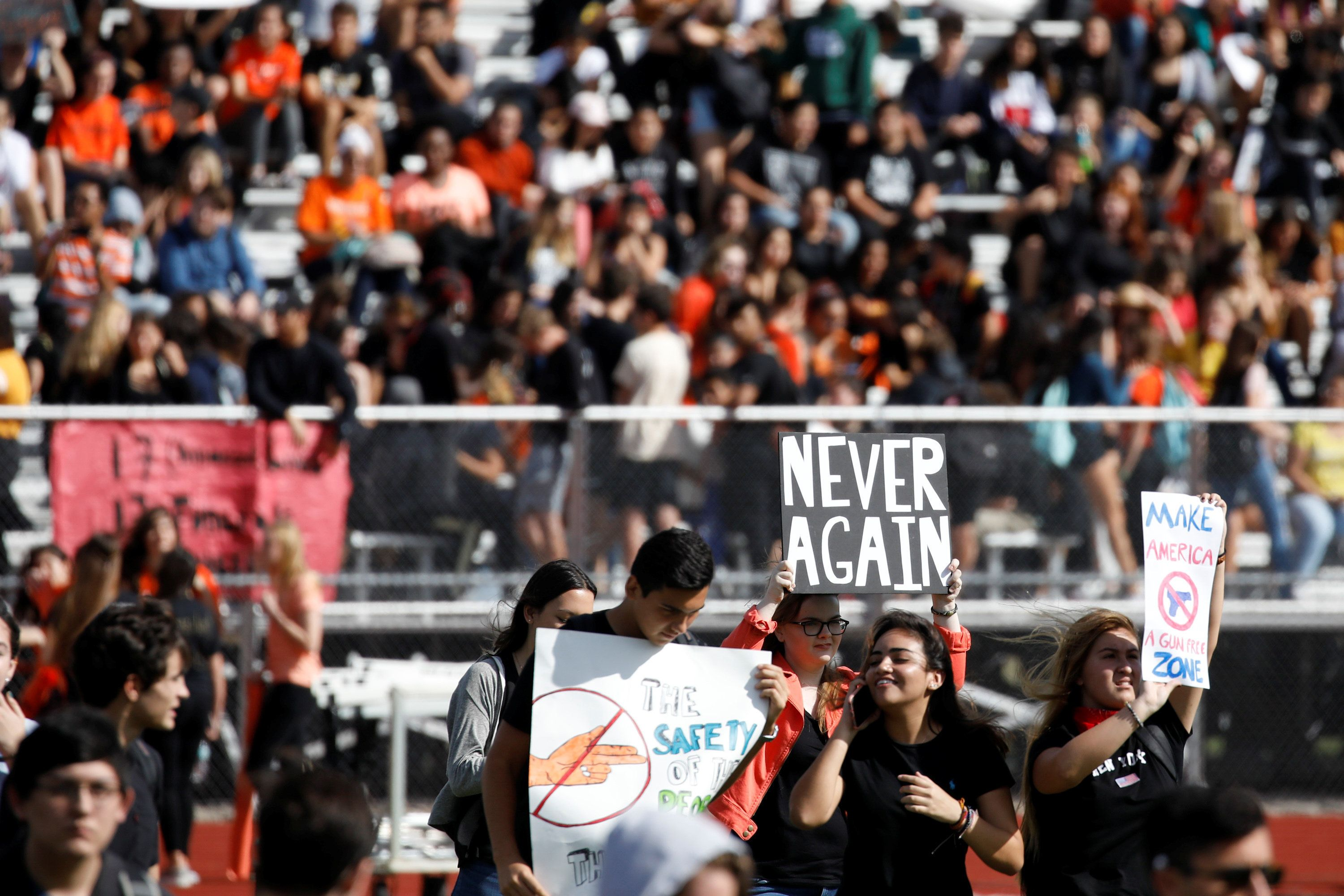 Students from Western High School carrying placards, take part in a protest in support of the gun control, following a mass shooting at Marjory Stoneman Douglas High School, in Davie, Florida, U.S, February 21, 2018. REUTERS/Carlos Garcia Rawlins