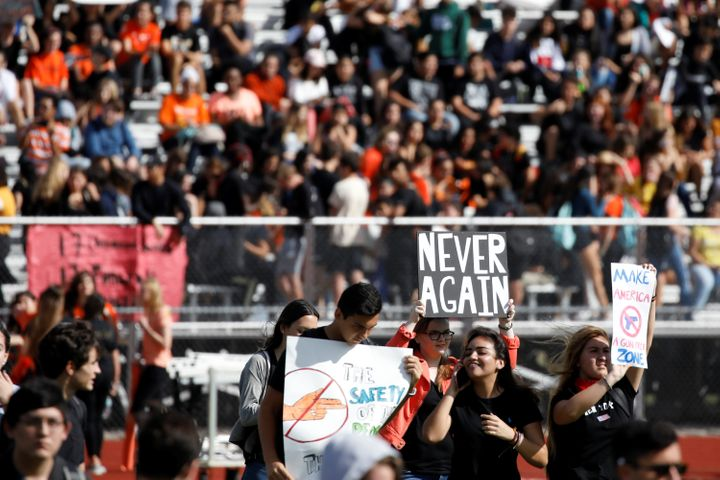 Students from Western High School in Davie, Florida, carrying placards, take part in a Feb. 21 protest in support of gun cont