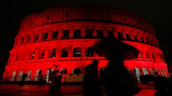 The Colosseum is lit up in red to draw attention to the persecution of Christians around the world in Rome, Italy, February 24, 2018.  REUTERS/Remo Casilli     TPX IMAGES OF THE DAY
