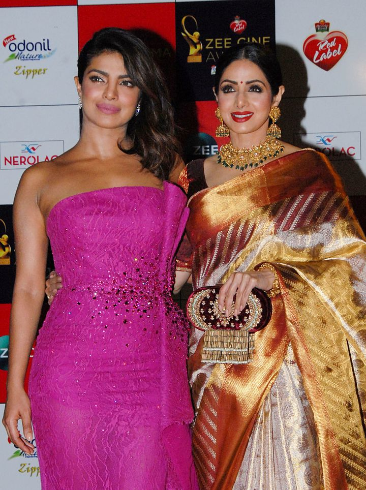 Indian Bollywood actress Priyanka Chopra (L) and Sridevi (R) attending the Zee Cine Awards 2018 ceremony in Mumbai on Decembe