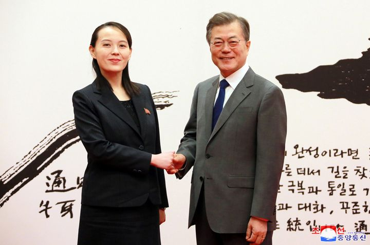 South Korean President Moon Jae-in shakes hands with Kim Yo Jong, the sister of North Korea's leader Kim Jong Un, in Seoul, S