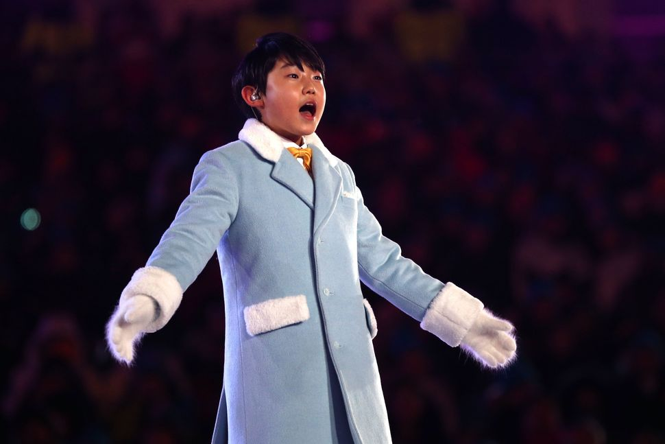 Singer Oh Yeon-joon performs the Olympic Anthem.