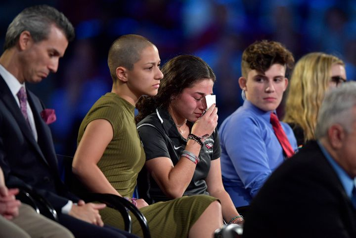 Marjory Stoneman Douglas High School student Emma Gonzalez comforts a classmate during a CNN town hall meeting on Wednesday,