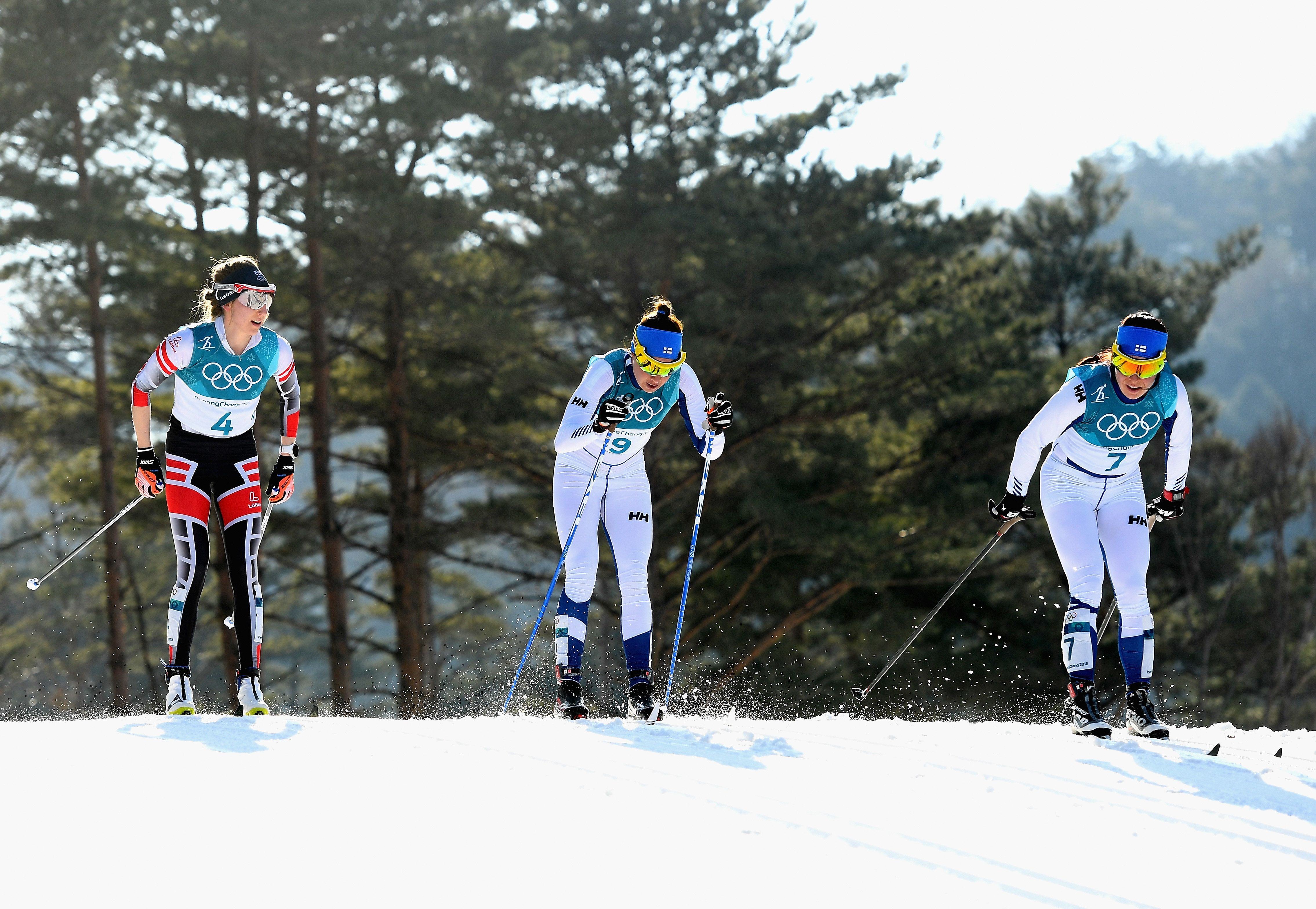 Teresa Stadlober of Austria is seen left ofKerttu Niskanen of Finland, center, and Krista Parmakoski...
