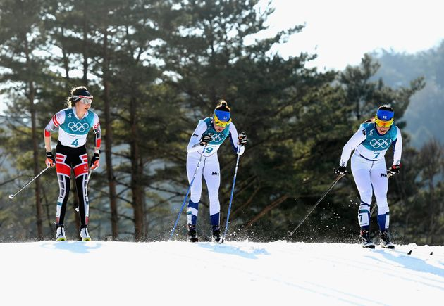 Teresa Stadlober of Austria is seen left of Kerttu Niskanen of Finland, center, and Krista Parmakoski...