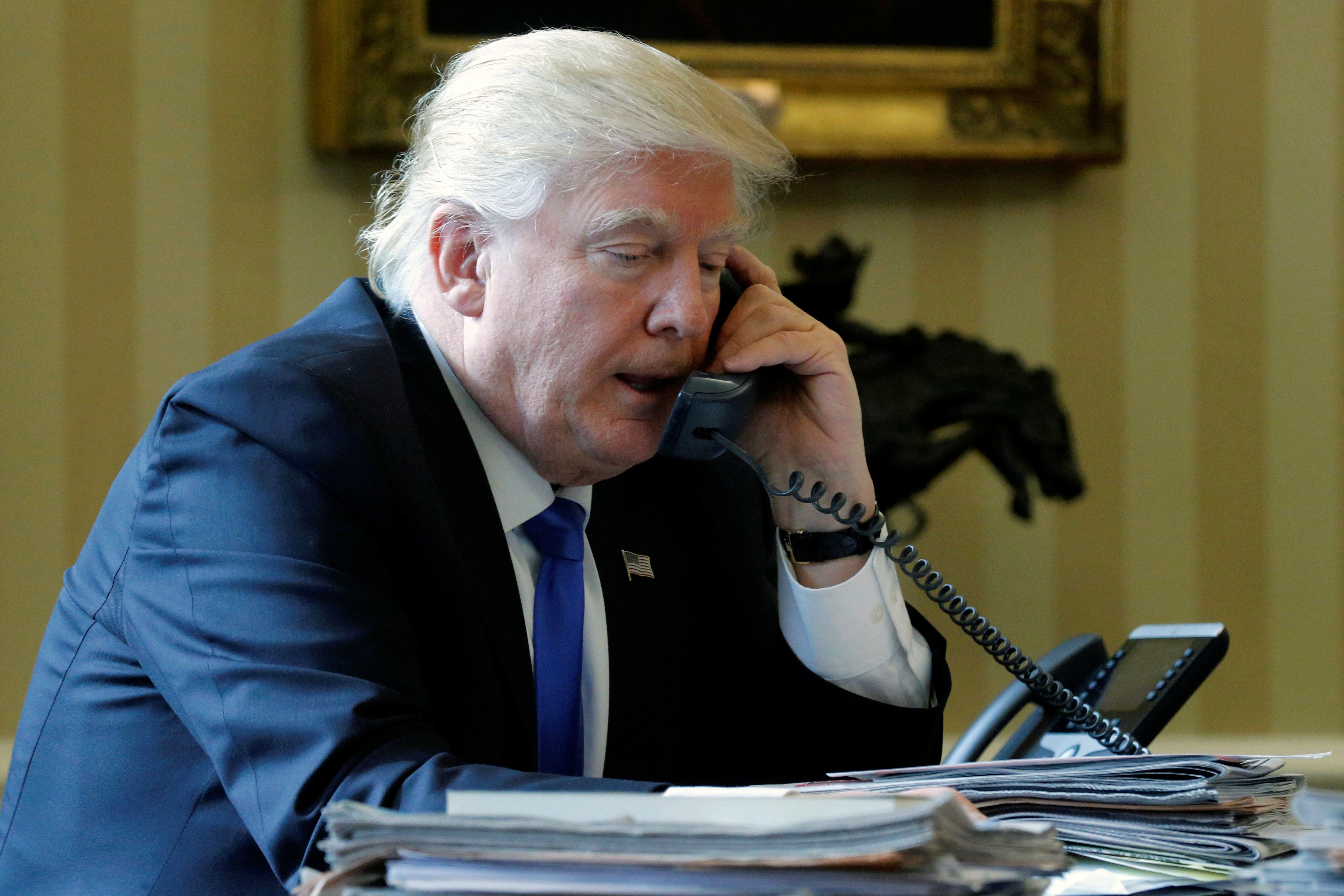 U.S. President Donald Trump speaks by phone with Russia's President Vladimir Putin in the Oval Office at the White House on J
