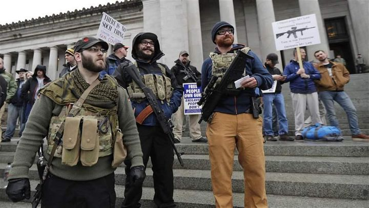 Gun rights supporters rally in Olympia, Washington, against several gun-control bills, including a ban on bump stocks, being