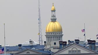 TRENTON, NJ - JUNE 24:  New Jersey State Capitol Building, New Jersey Flags Fly at Half Staff in Honor of Actor James Gandolfini on June 24, 2013 in Trenton, New Jersey.Gandolfini passed away on June 19, 2013 at the age of 51 while on vacation in Rome, Italy.  (Photo by Bobby Bank/WireImage)