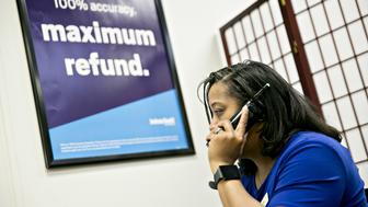 A tax preparer talks on the phone at a Jackson Hewitt Tax Service Inc. office in Washington, D.C, U.S., on Friday, Dec. 29, 2017. The tax-overhaul bill that President Donald Trump signed into law last week will limit the deduction that individuals can take for the state and local taxes they pay. As of January 1, the deduction will be capped at $10,000, a limit that applies to any combination of property taxes and income or sales taxes. Photographer: Andrew Harrer/Bloomberg via Getty Images