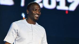 Host of AFRIMA, Senegalese born US artist Akon speaks during the All Africa Music Awards (AFRIMA) in Lagos November 12, 2017.   / AFP PHOTO / PIUS UTOMI EKPEI        (Photo credit should read PIUS UTOMI EKPEI/AFP/Getty Images)