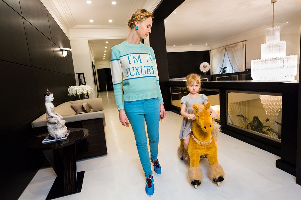 Ilona at home with her daughter, Michelle, 4, in Moscow. Ilona's sweater was produced for her in a custom color by her