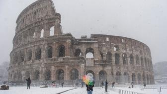 ROME, ITALY - FEBRUARY 26: A person walks in front of the Colosseum during a snow storm on February 26, 2018 in Rome, Italy.  Rome is seeing snow for the first time in six years while many other European cities also have freezing weather.  (Photo by Antonio Masiello/Getty Images)